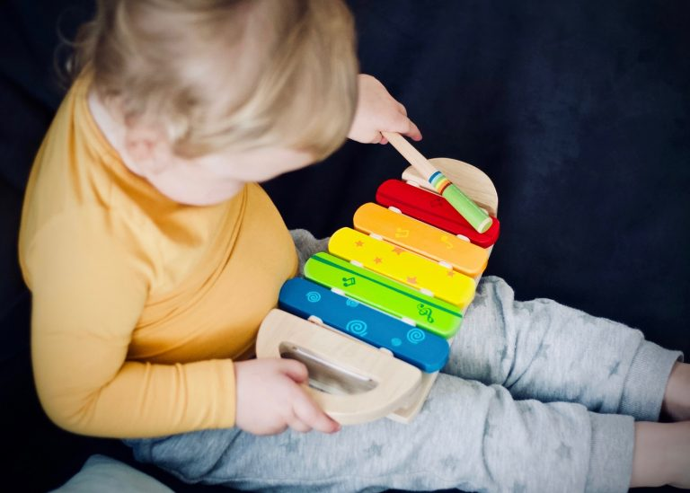 Toddler beating the xylophone