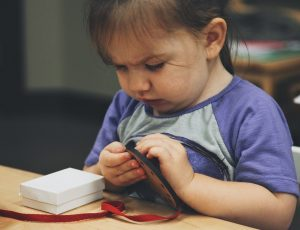 Toddler learning to work with laces