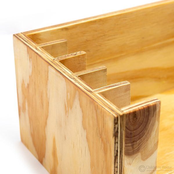 A wooden dressing frame stand to hold 5 frames