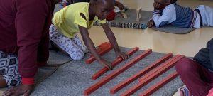 Ikhaya Labantwana Montessori - the Child at Work with Red Rods